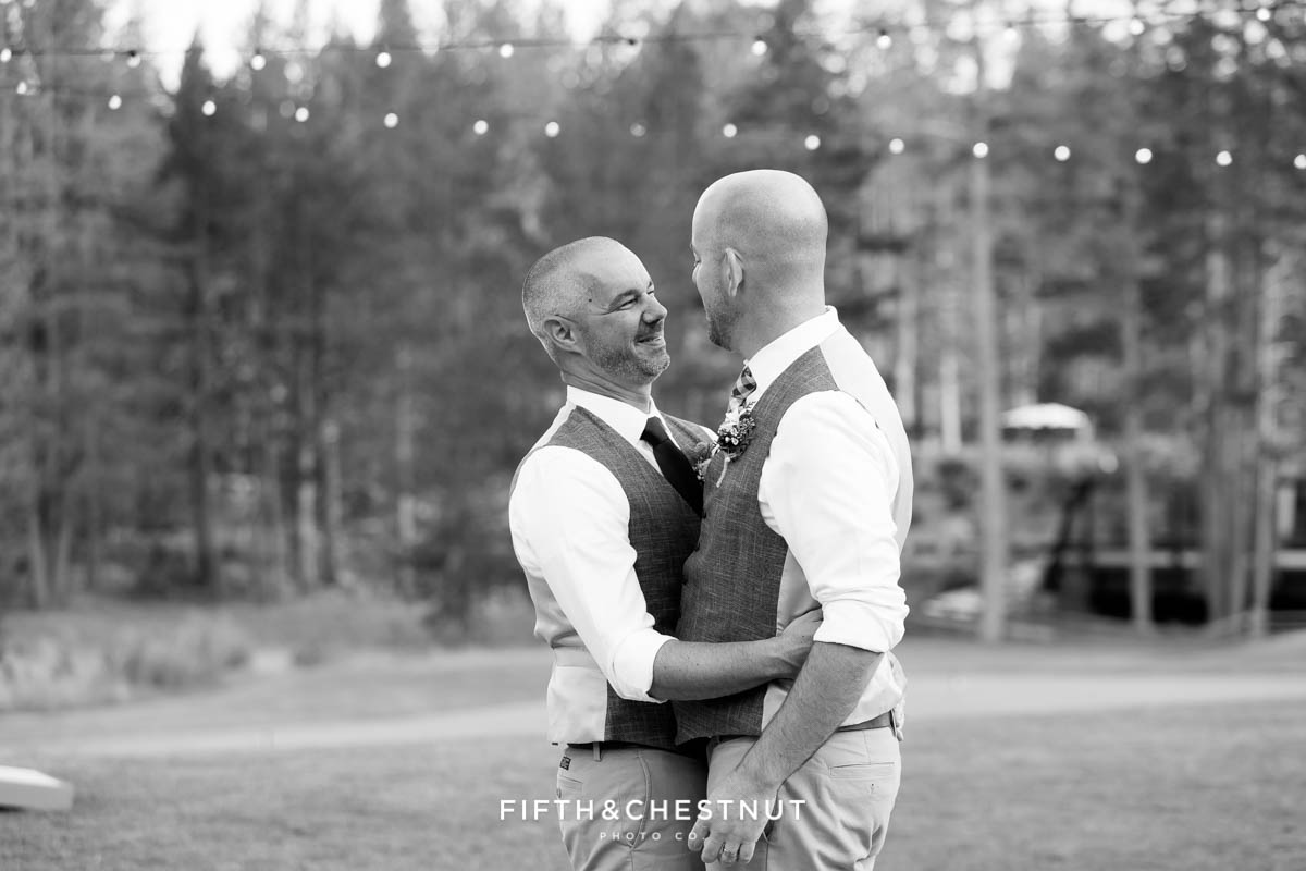 Grooms take their first dance as husband and husband at a gay wedding at PJ's at Gray's Crossing in Truckee