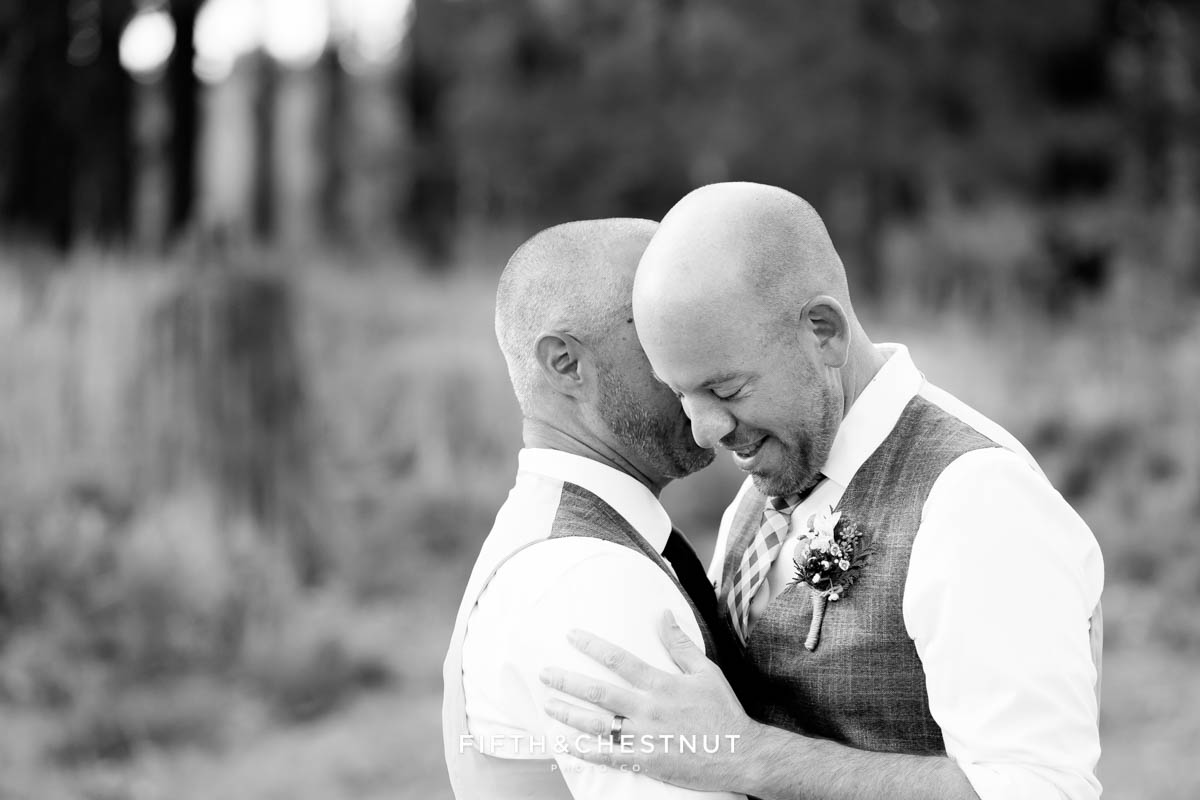 Grooms embrace during first dance for a PJ's at Gray's Crossing wedding