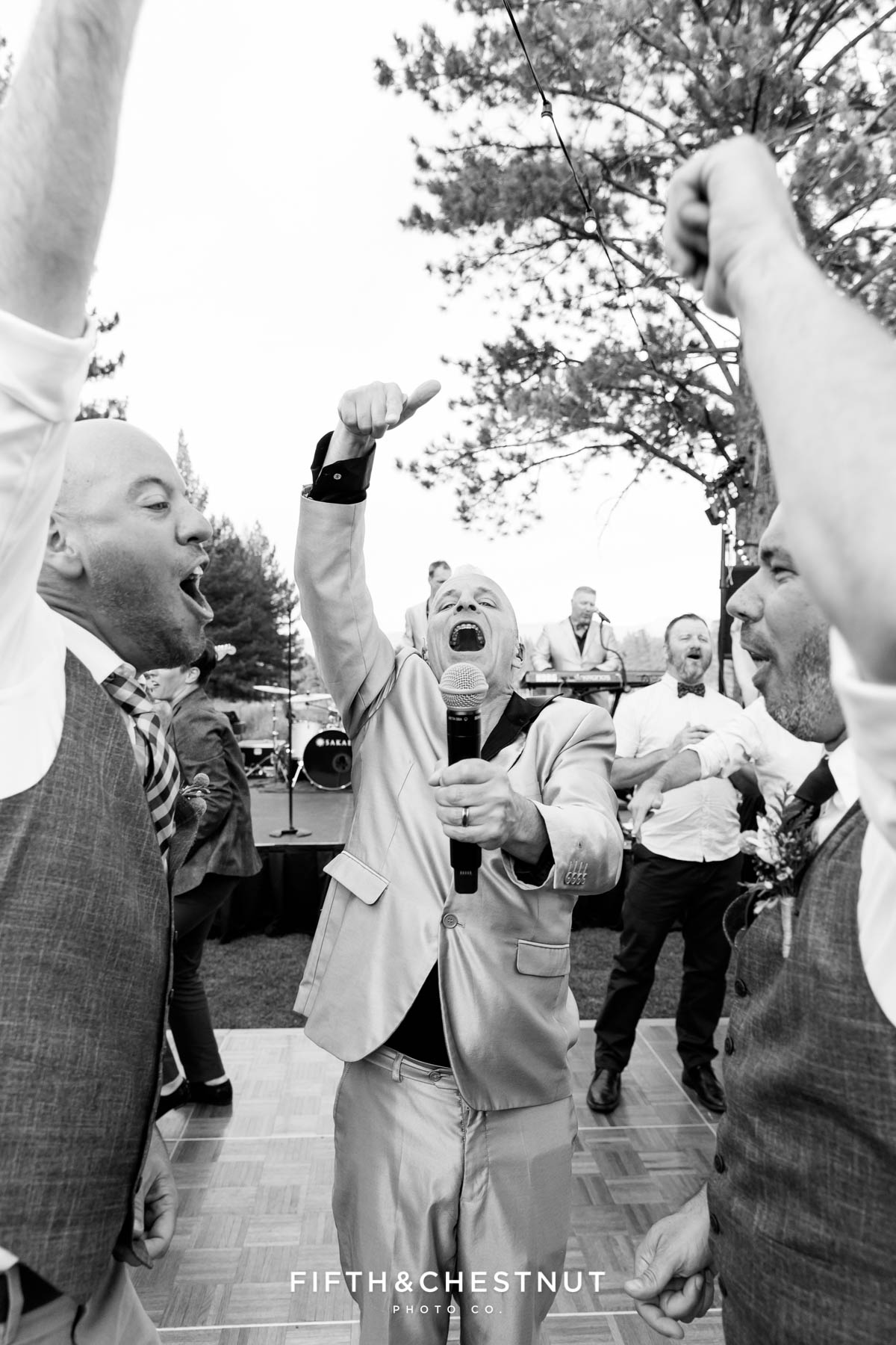 Lead singer of wonderbread5 gets grooms involved for a song during their gay wedding at PJ's at Gray's Crossing in Truckee