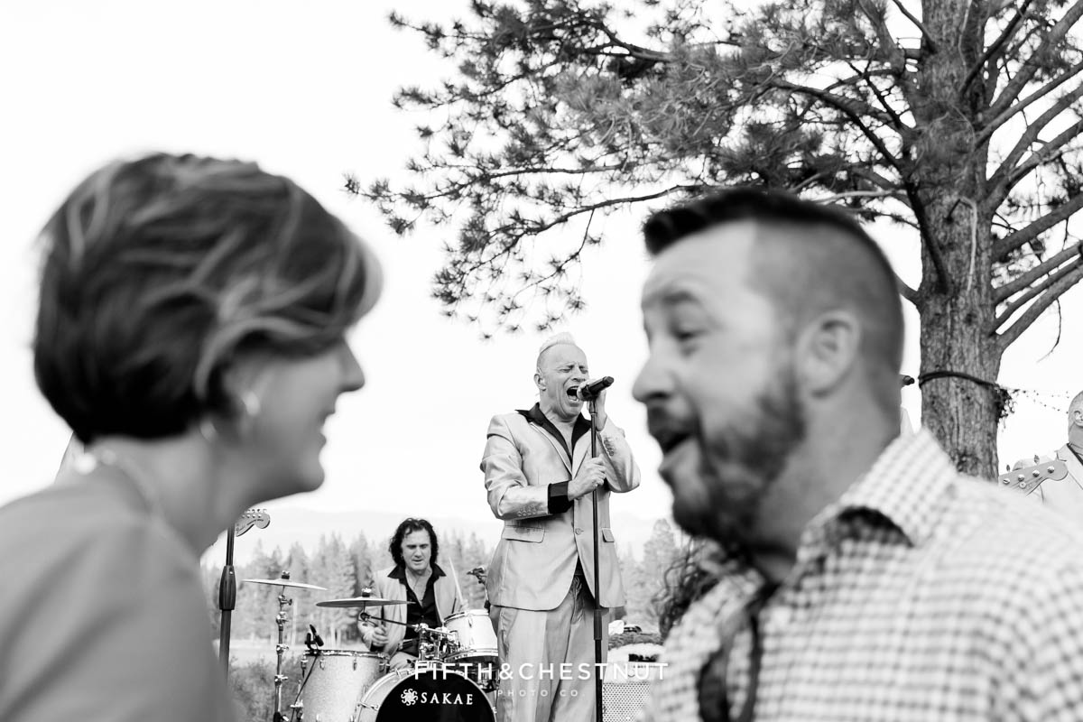 Guests dance as wonderbread5 performs at a same-sex wedding in Truckee