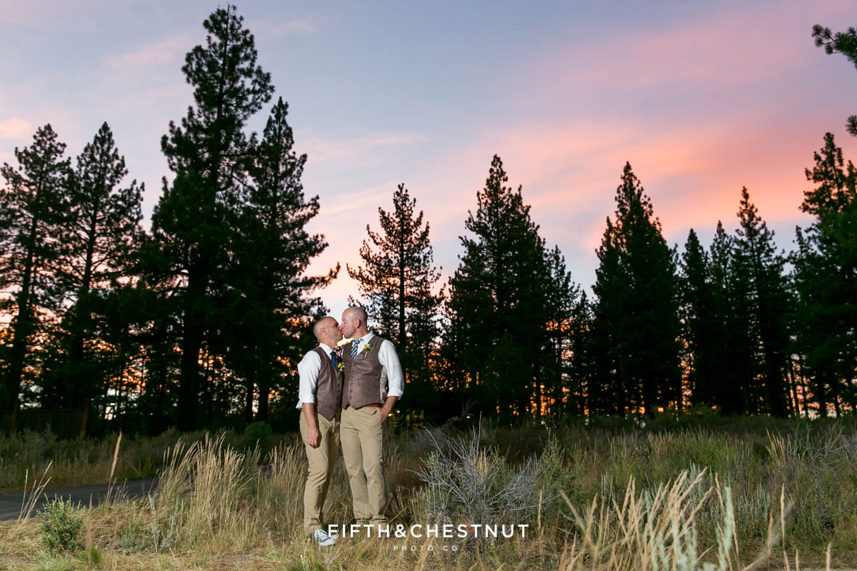 Grooms kiss at sunset for their PJ's at Gray's Crossing wedding