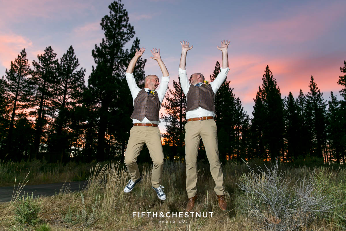 Grooms jump for joy during sunset at their PJ's at Gray's Crossing wedding