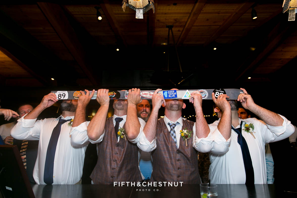 grooms and groomsmen do shots from a shotski during a Truckee Wedding at PJ's at Gray's Crossing