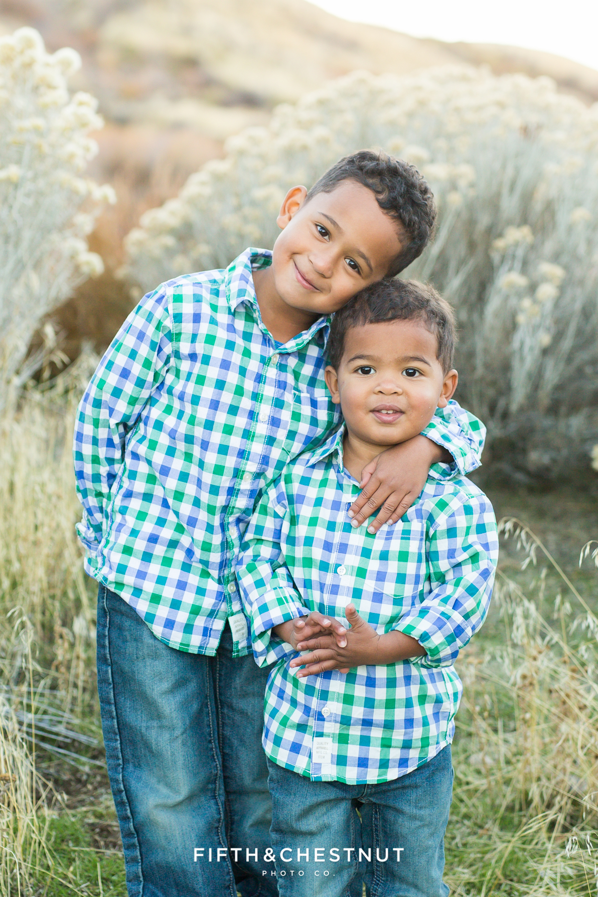 Mayberry Park Portraits of toddlers dressed in matching plaid shirts