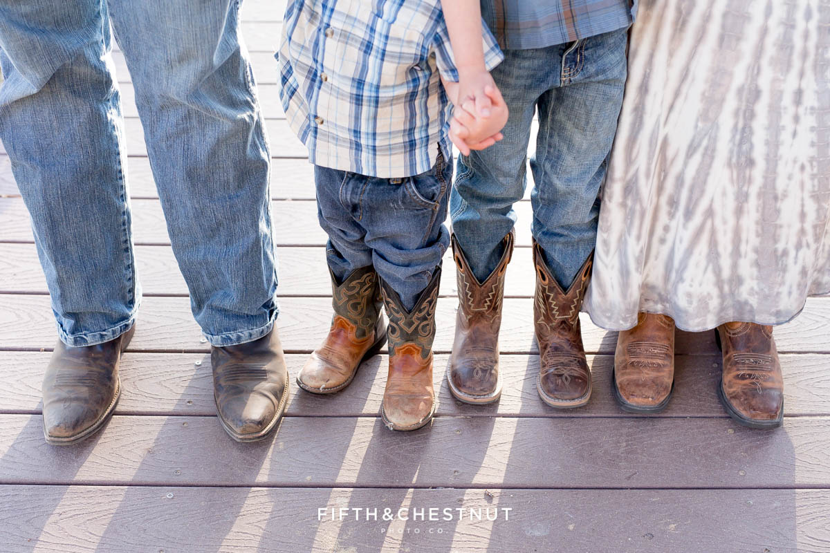 A closeup of a family wearing boots for their rustic Tahoe Maternity Portraits