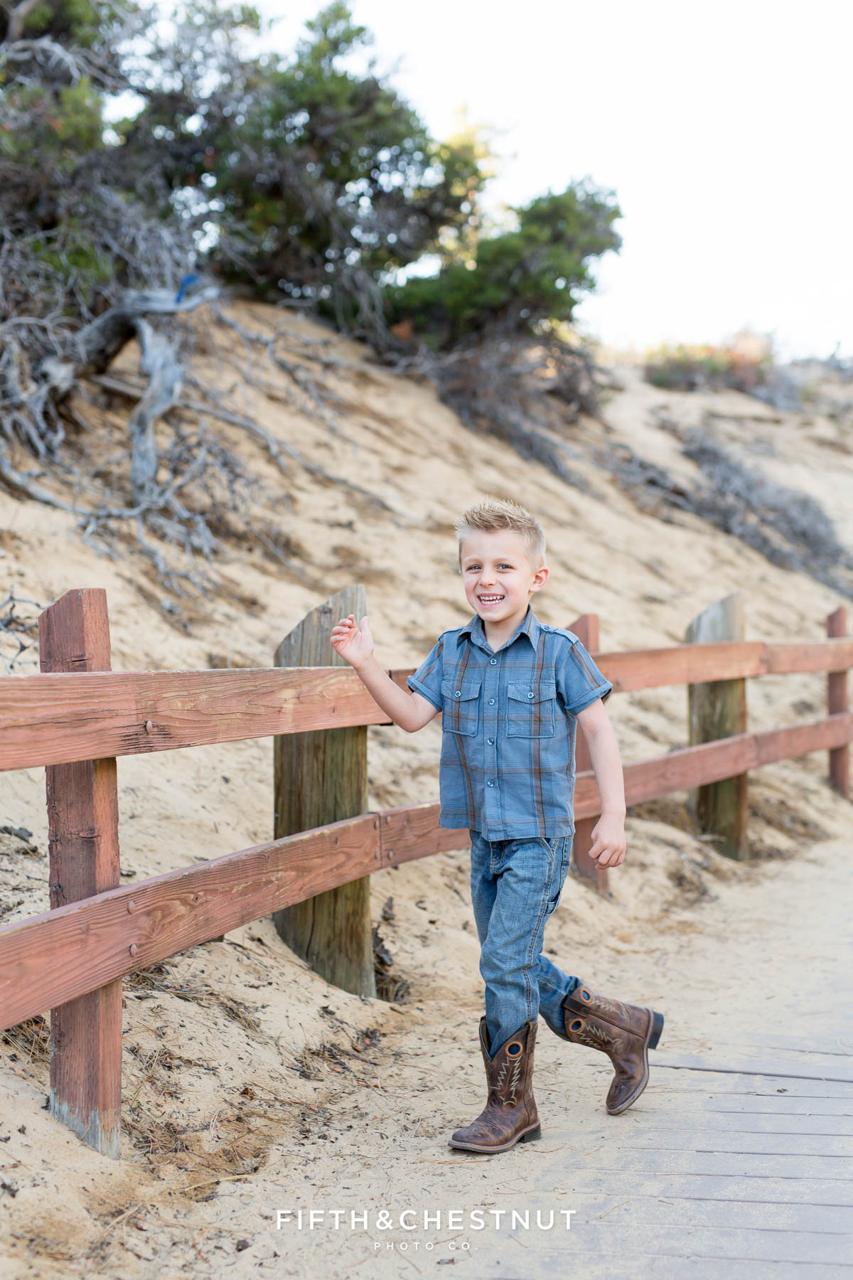 little boy running on the sand harbor nature path for child portraits by Reno family photographer