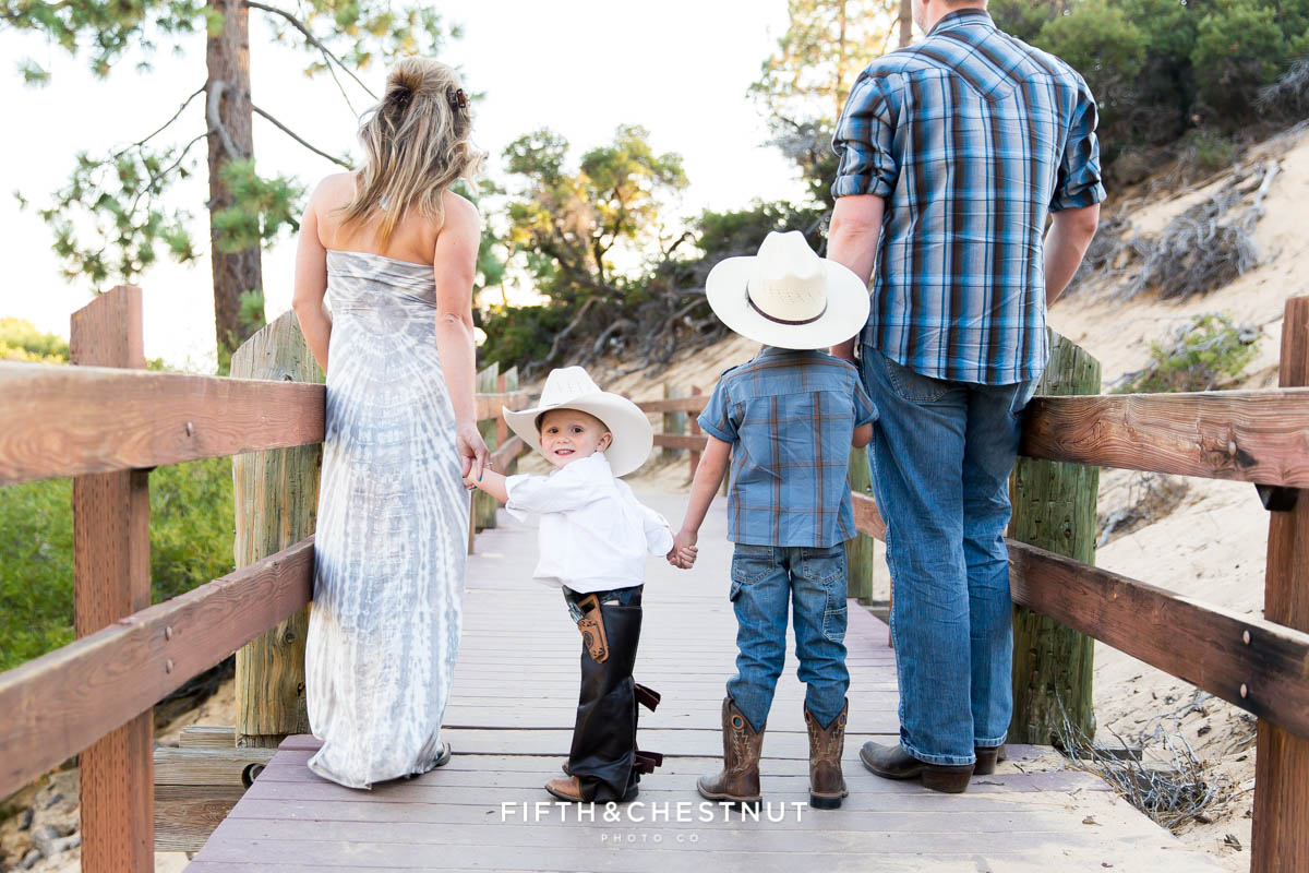 family stands with toddler who is in assless chaps and is looking at the camera