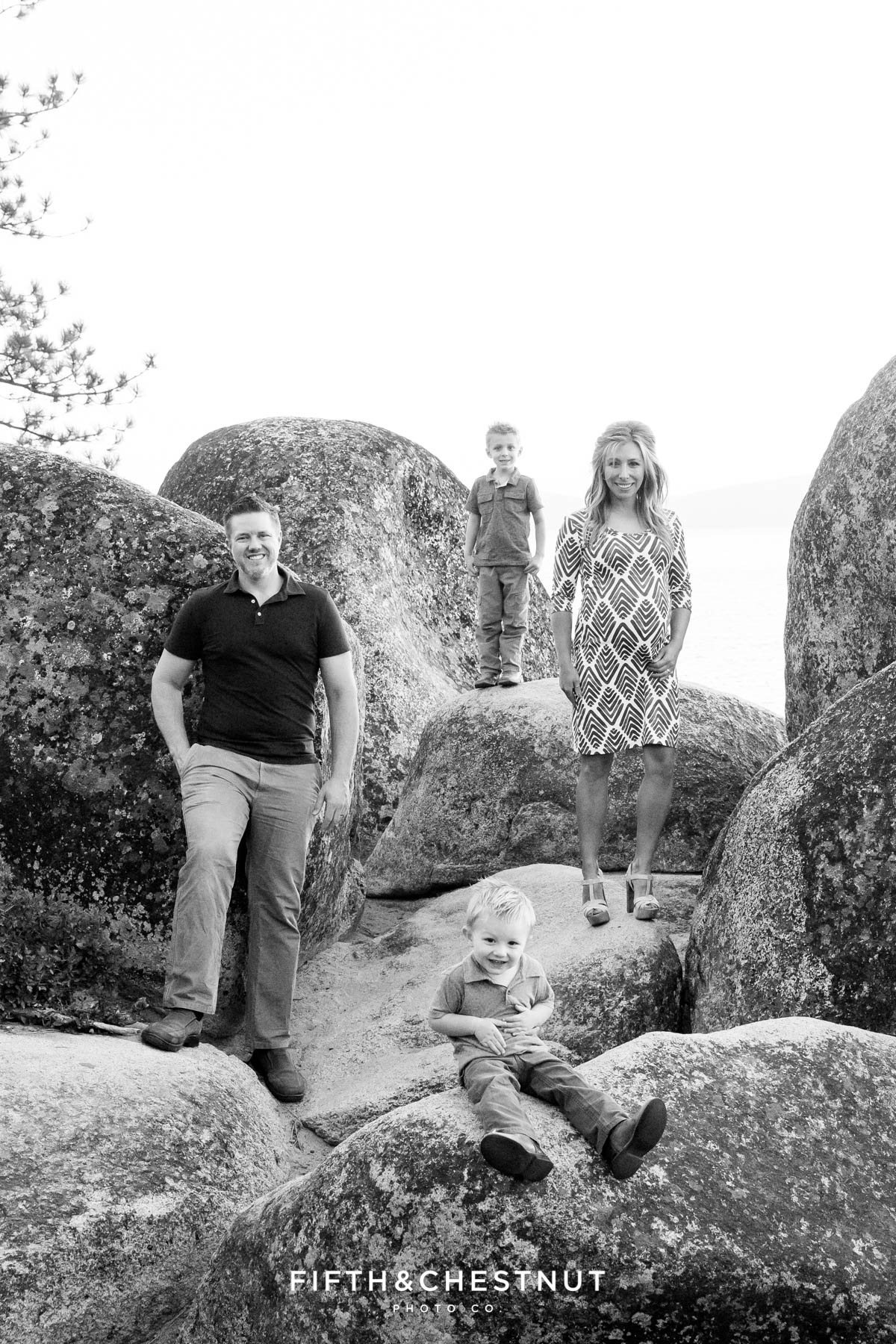 family stands on separate rocks for a cool tahoe maternity portrait at sand harbor