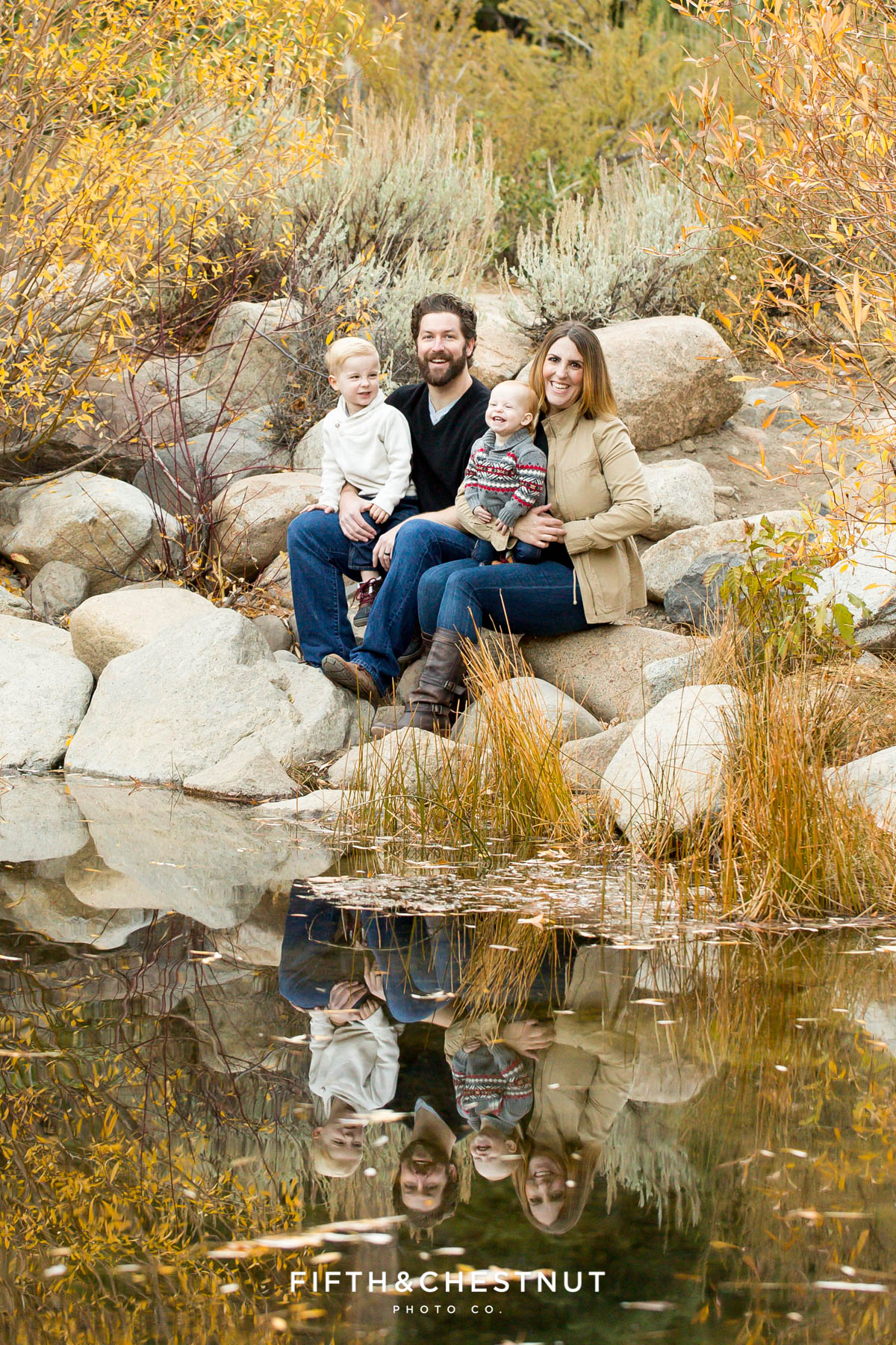 A family of four and their reflection in a pond for Fall Galena Creek Portraits by Reno Family Photographer