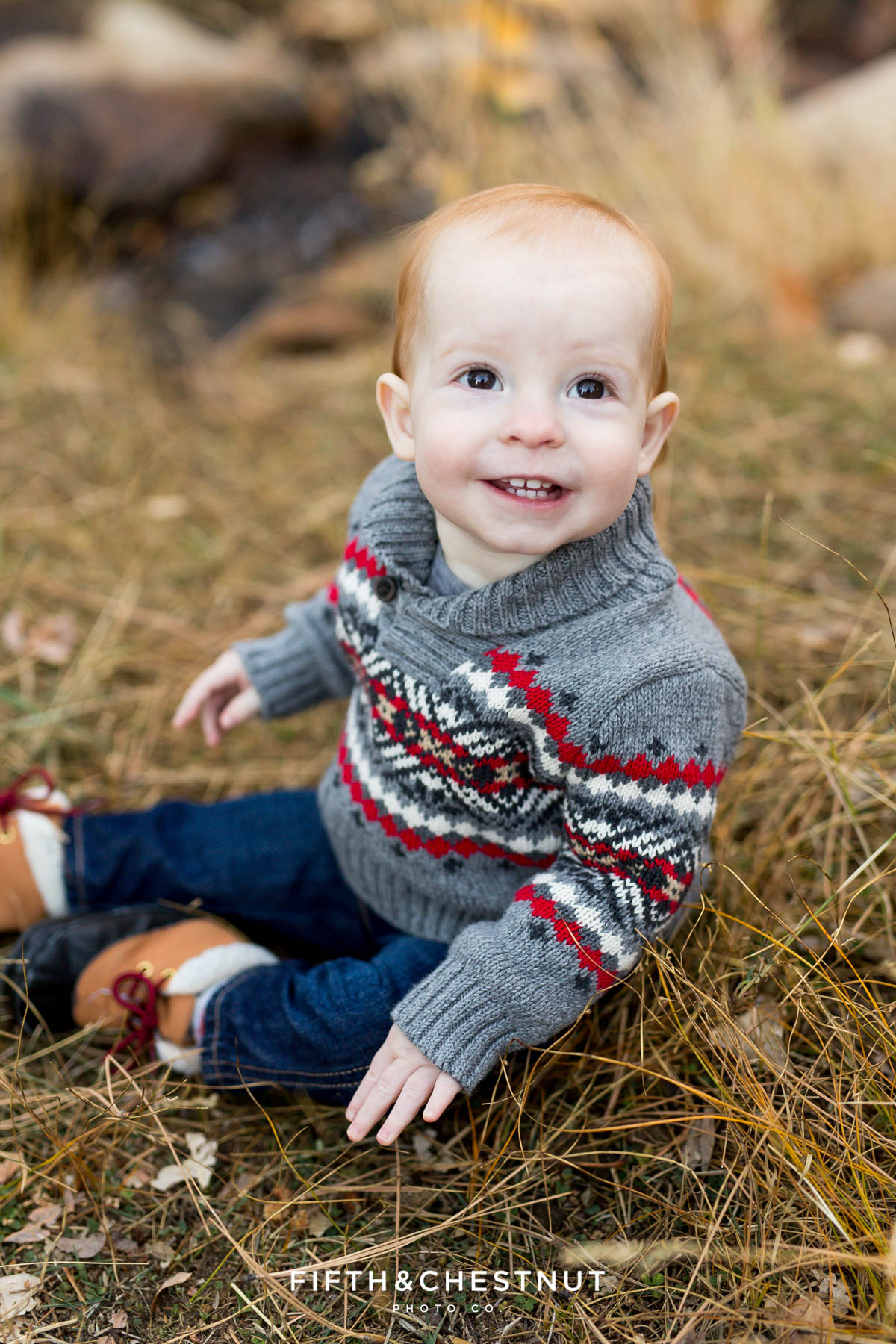 baby smiles and looks up for his Fall Galena Creek Portraits
