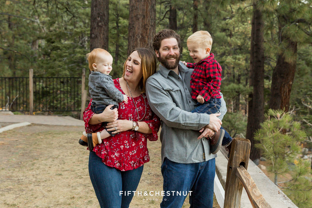 Family of four wearing shades of red and gray for their reno family photos at galena creek park