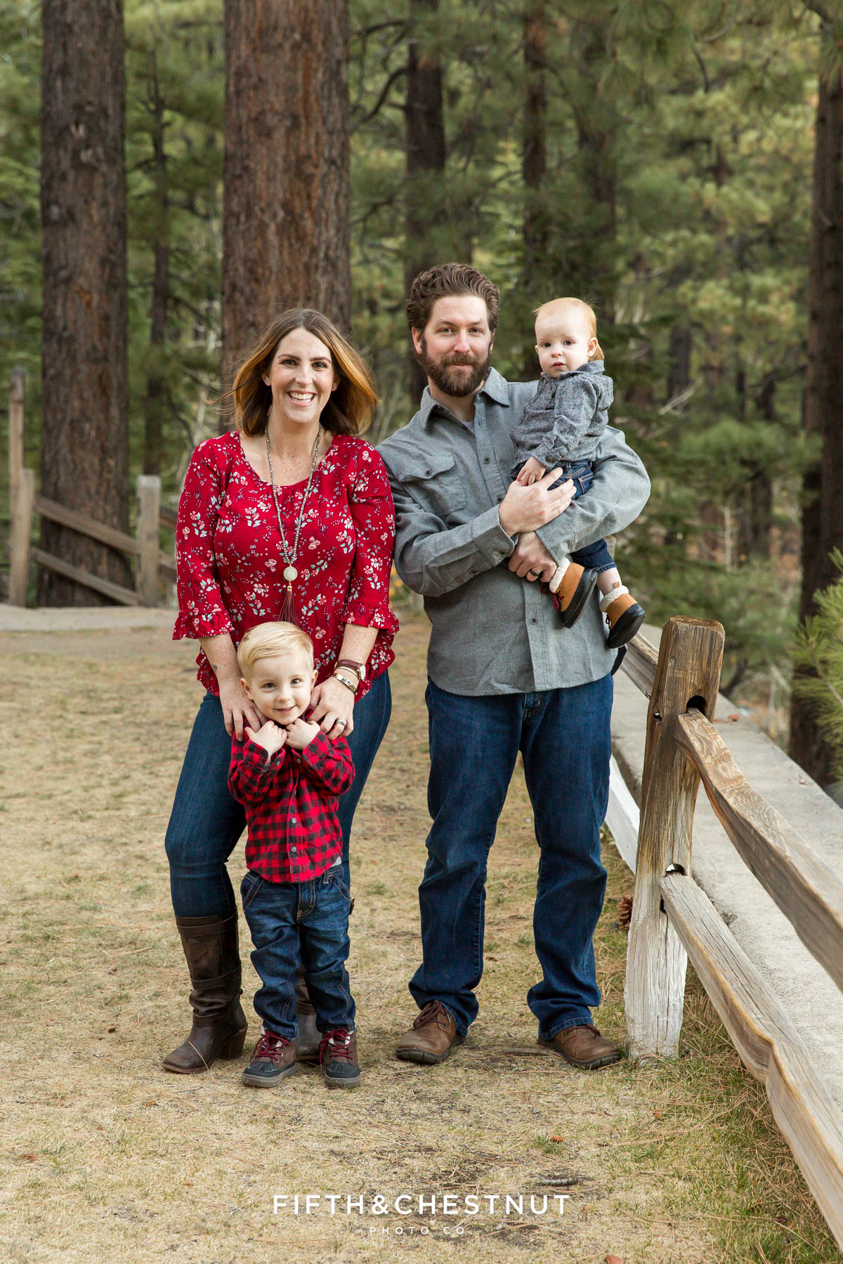 Sweet family of four poses for reno family photos at galena creek park wearing red and gray