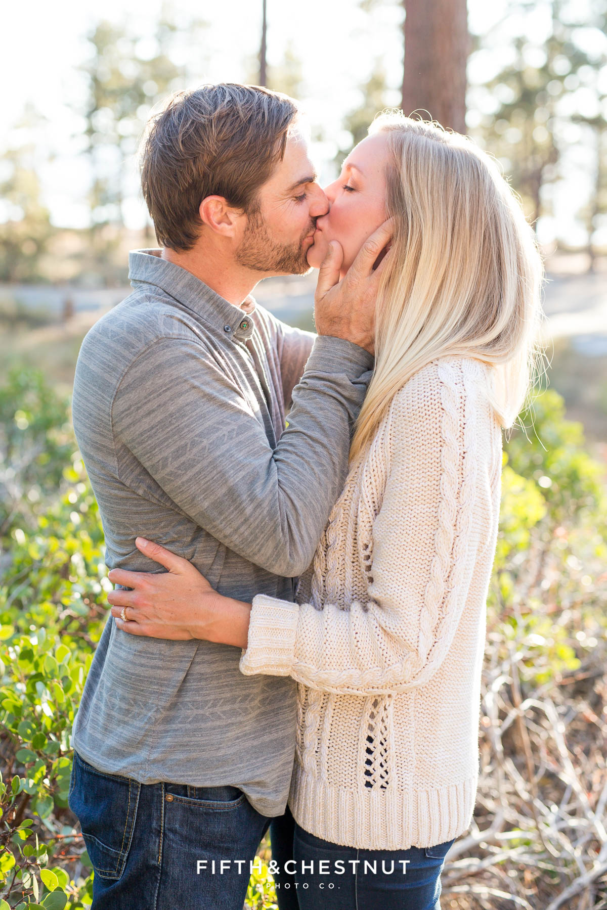 engaged couple kissing in a sweet embrace during fall Nevada Beach engagement by Lake Tahoe wedding photographer
