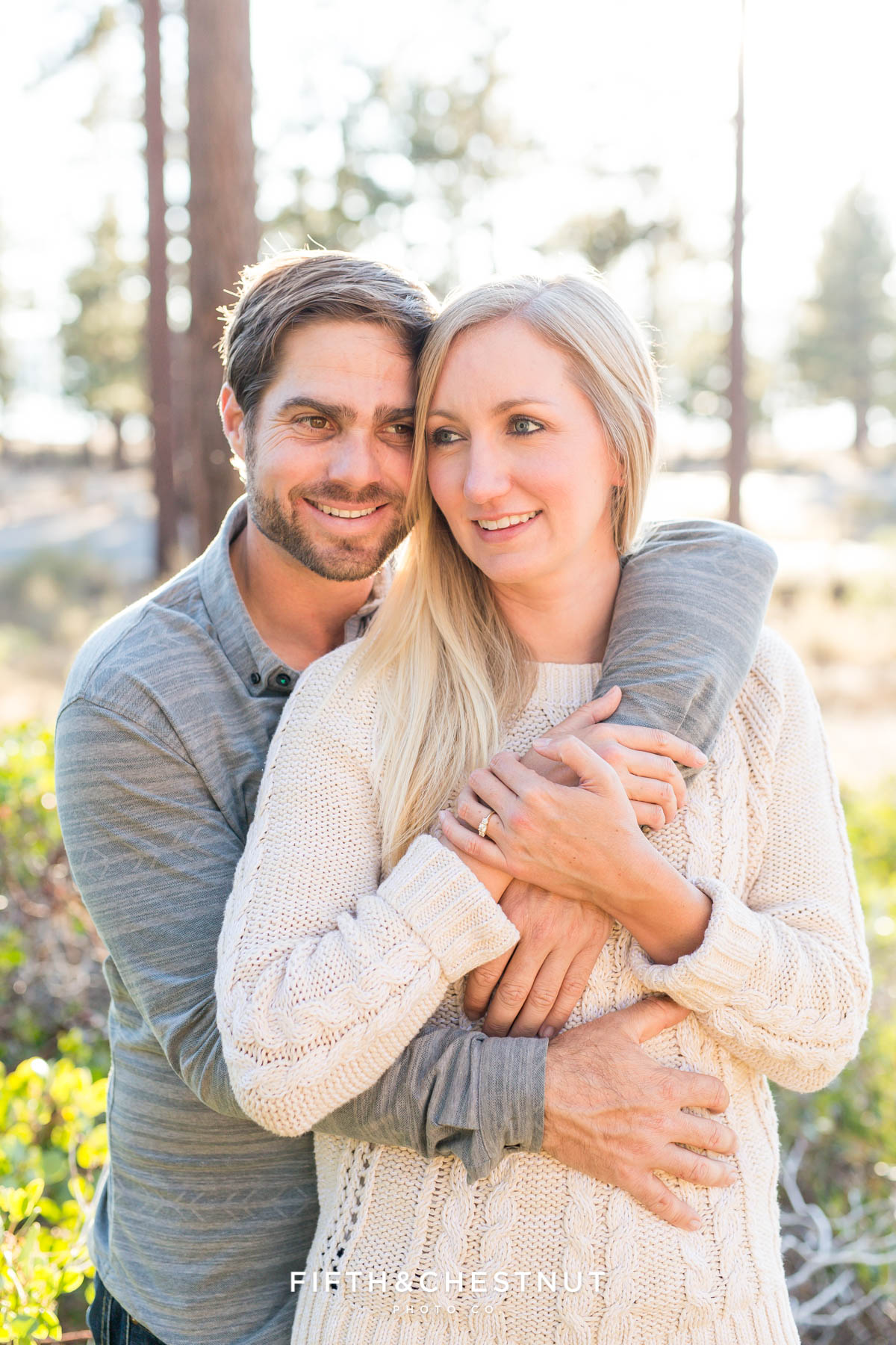Couple gets snuggly at Nevada beach for their fall engagement photos in Lake Tahoe