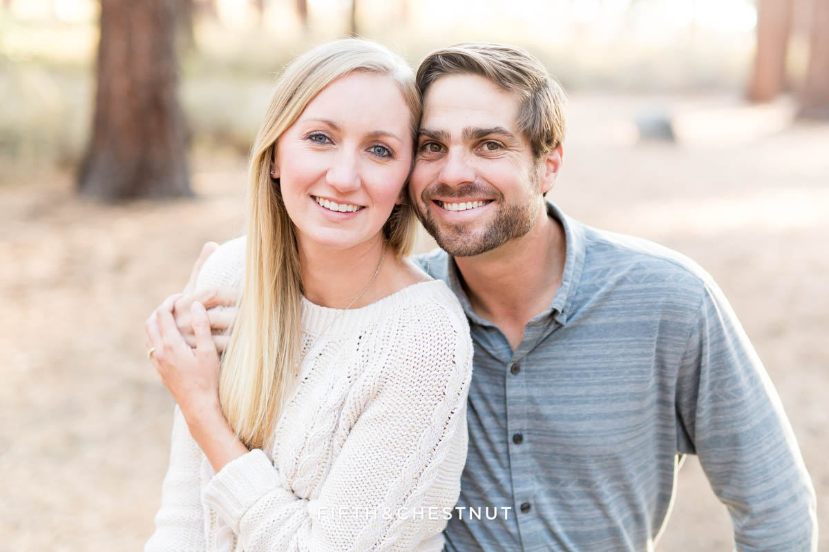 Closeup portrait of engaged couple smiling at Nevada Beach for their engagement portraits