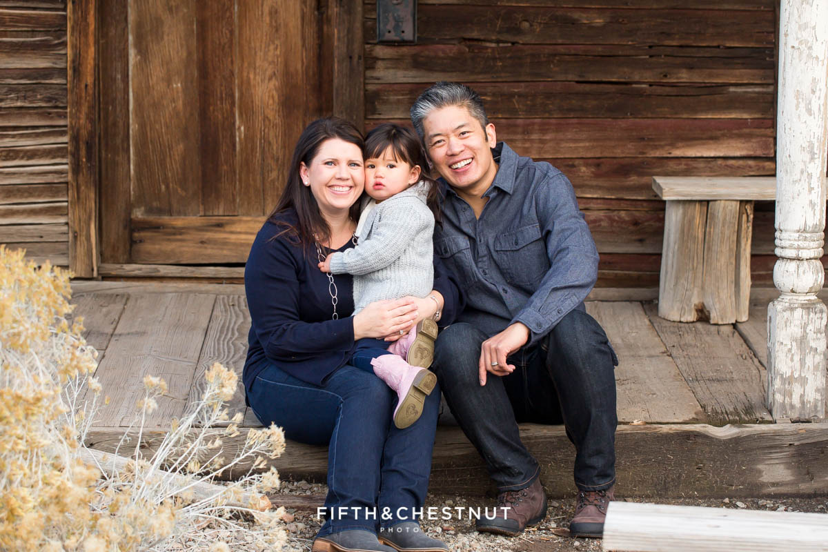 Adorable Reno Family Portraits in front of old ranch cabins at Bartley Ranch by Reno Family Photographer