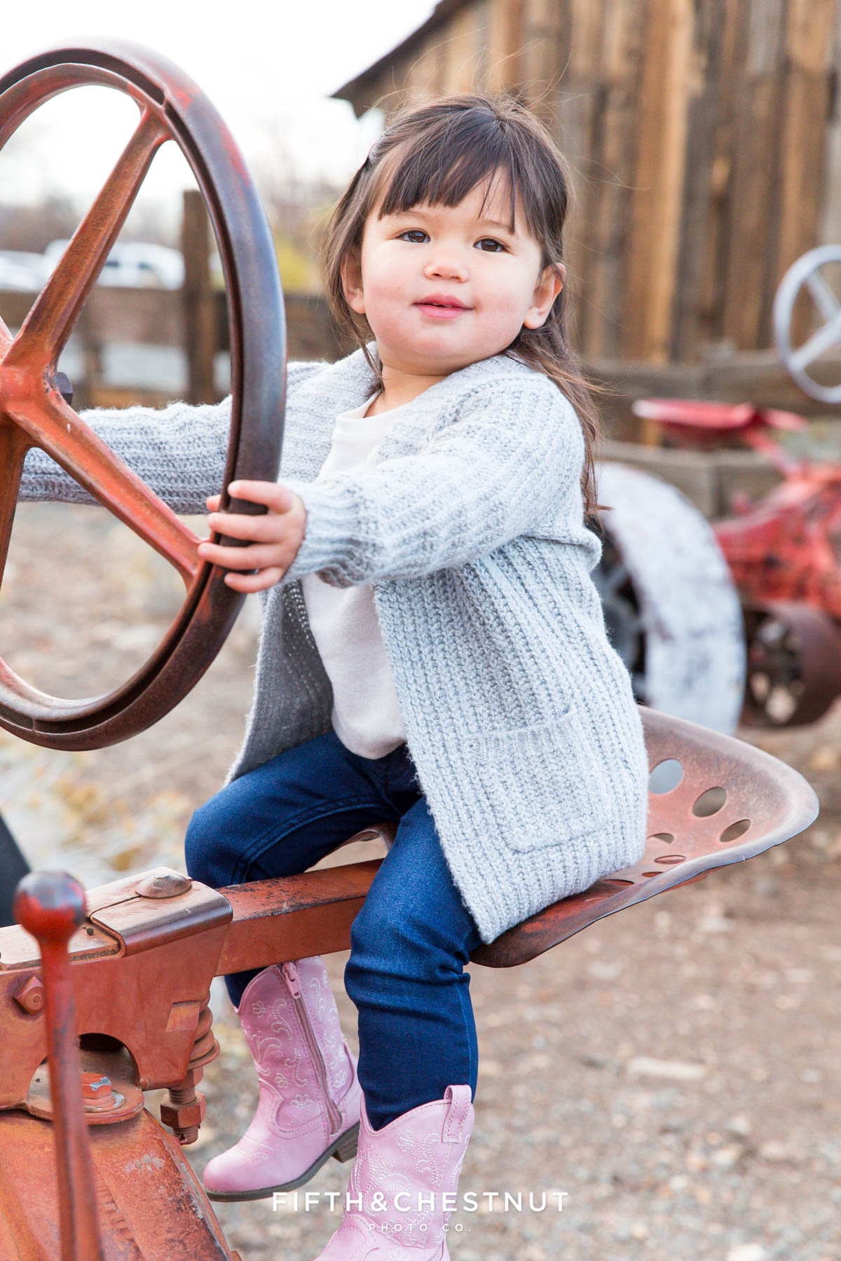 Toddler driving tractor at Bartley Ranch for Adorable Reno Family Portraits by Reno Family Photographer