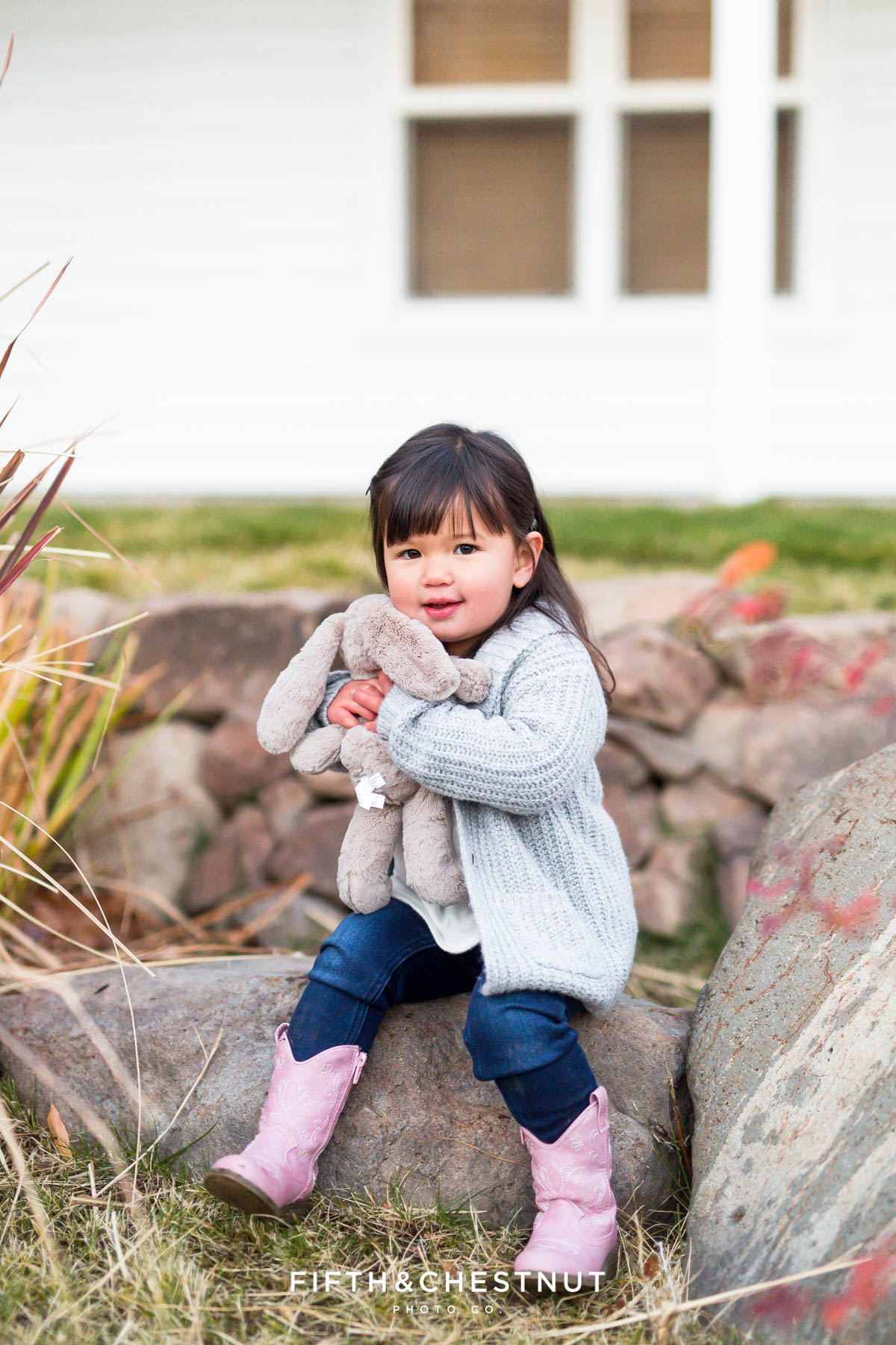 Sweet toddler holds her stuffed bunny at Bartley Ranch for her adorable family portraits by Reno Family Photographer