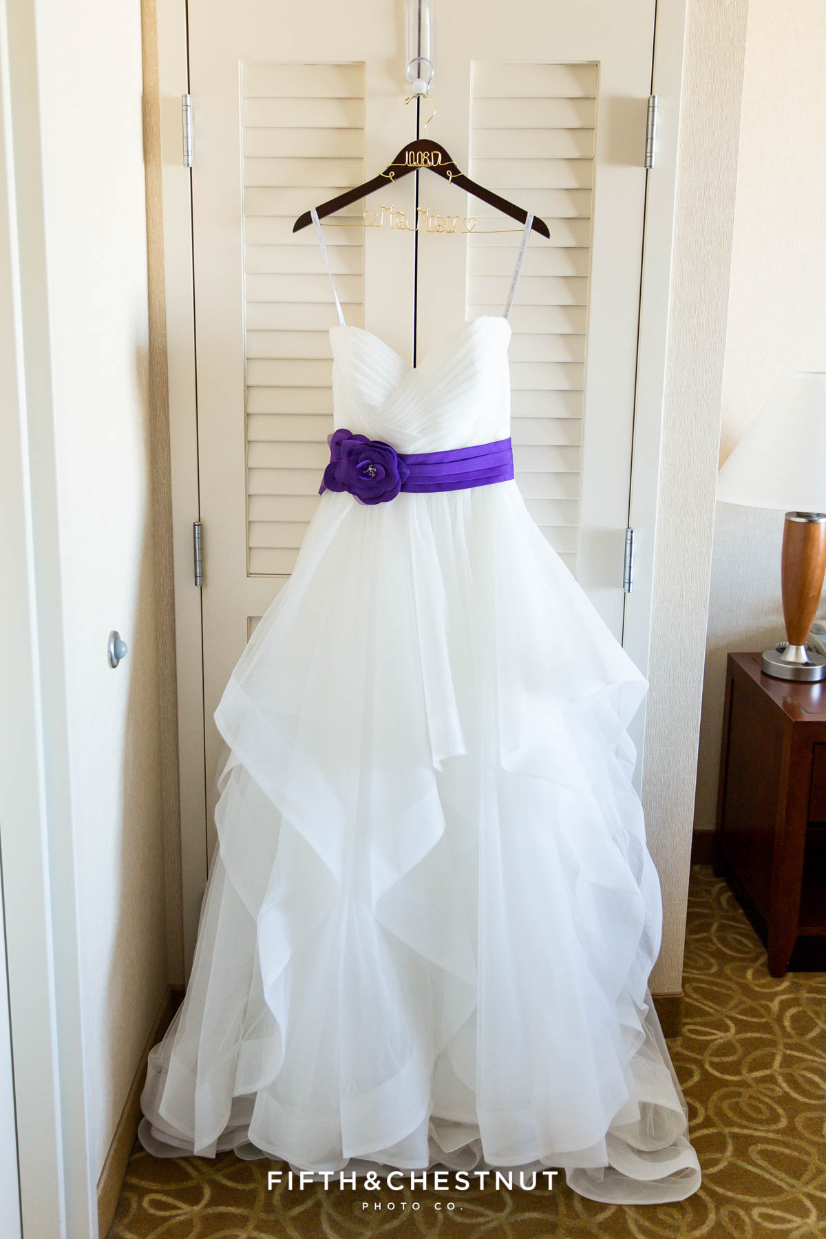 Dress hanging in a hotel room for a Bright fall wedding at the Grove by Reno Wedding Photographer
