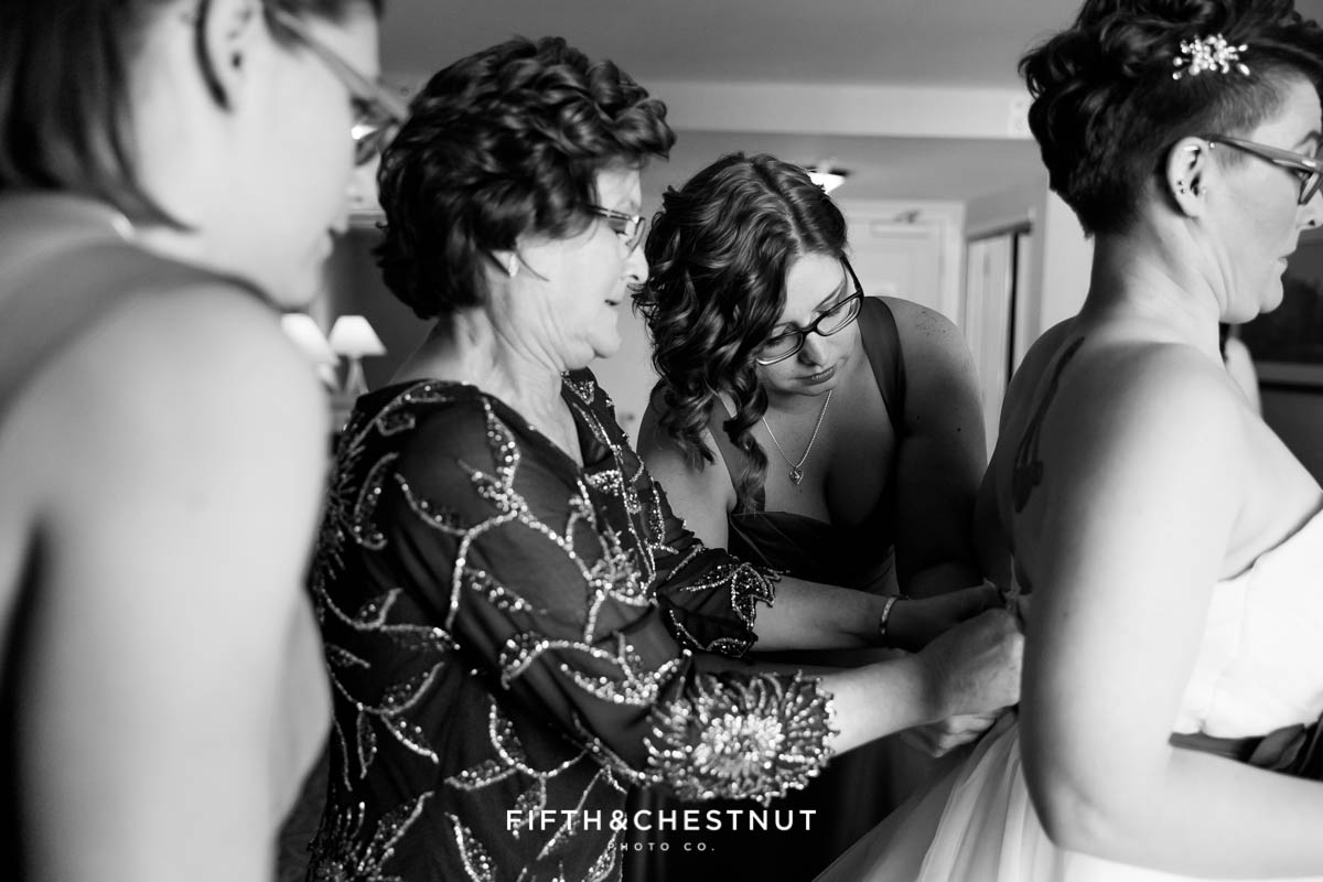 Bride getting dressed before her Bright fall wedding at the Grove by Reno Wedding Photographer
