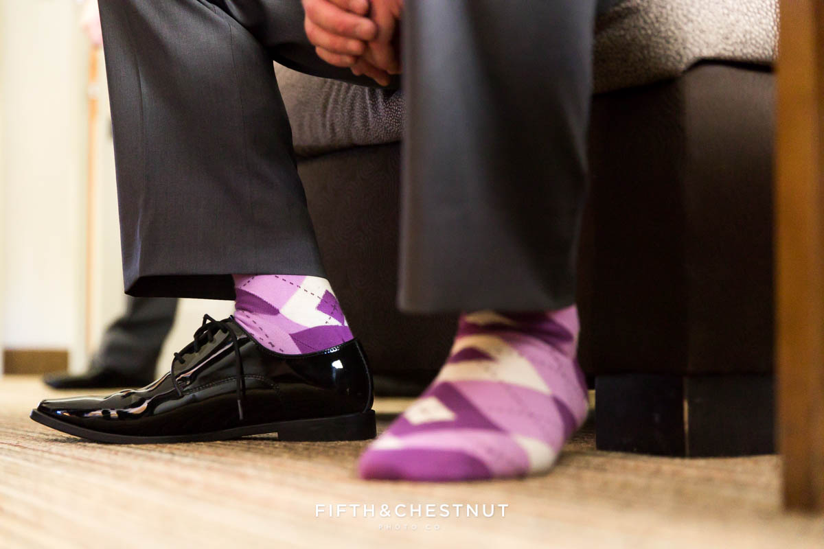 Groom's purple argyle socks and black shoes for a Bright fall wedding at the Grove by Reno Wedding Photographer