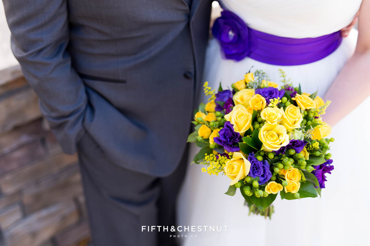 bride holding bouquet next to groom at a Bright fall wedding at the Grove by Reno Wedding Photographer