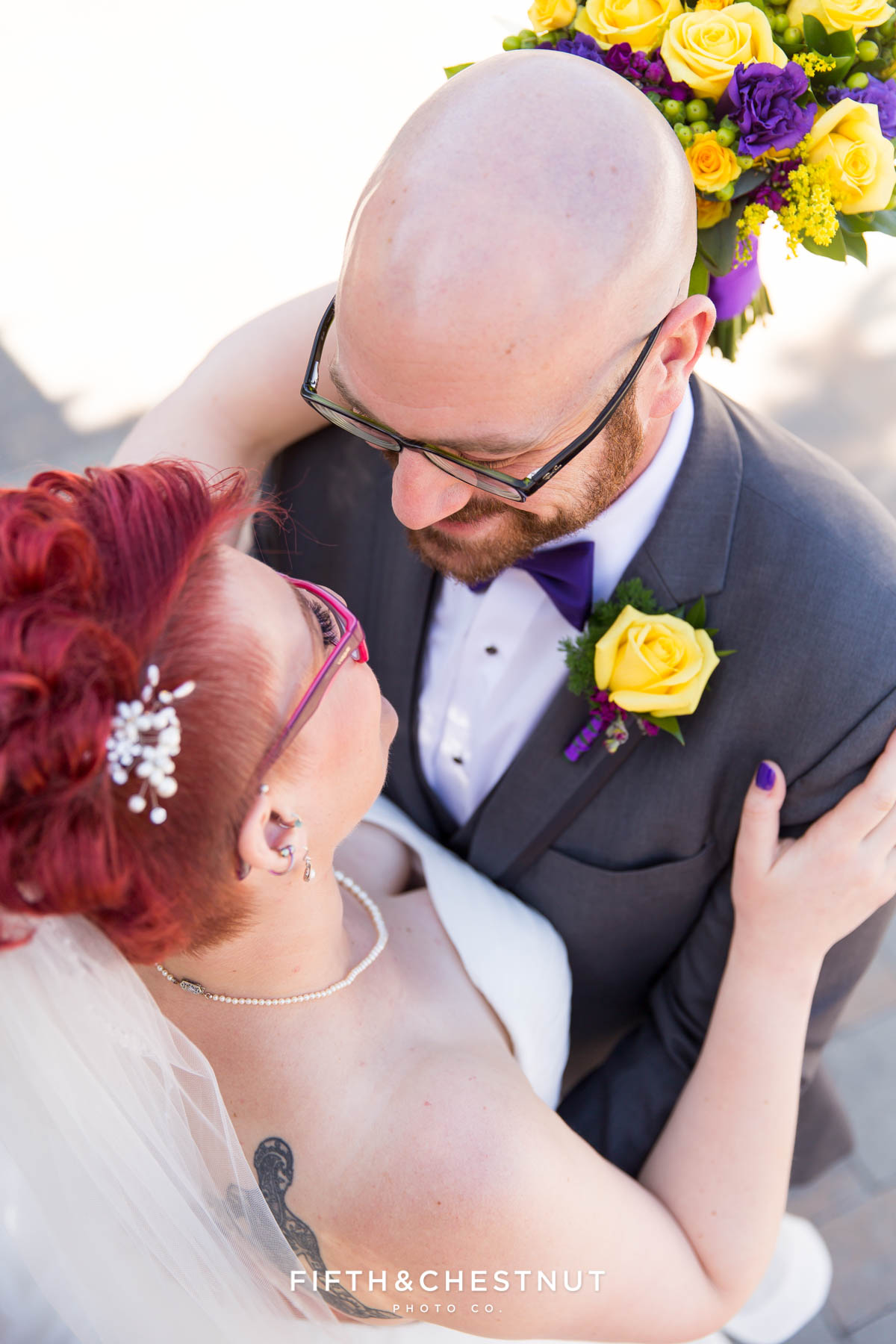 bride and groom look at each other before their Bright fall wedding at the Grove by Reno Wedding Photographer