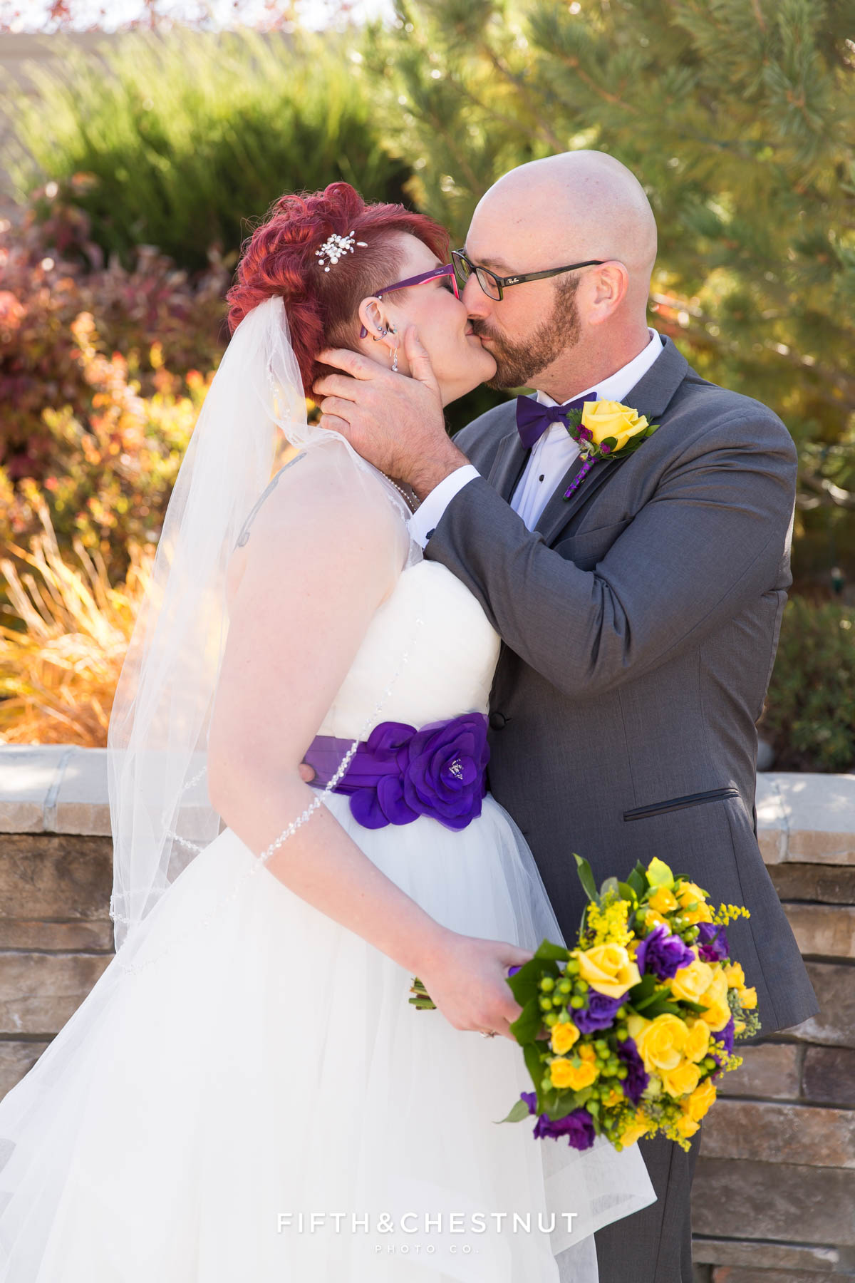 bride and groom kiss during their Bright fall wedding at the Grove by Reno Wedding Photographer