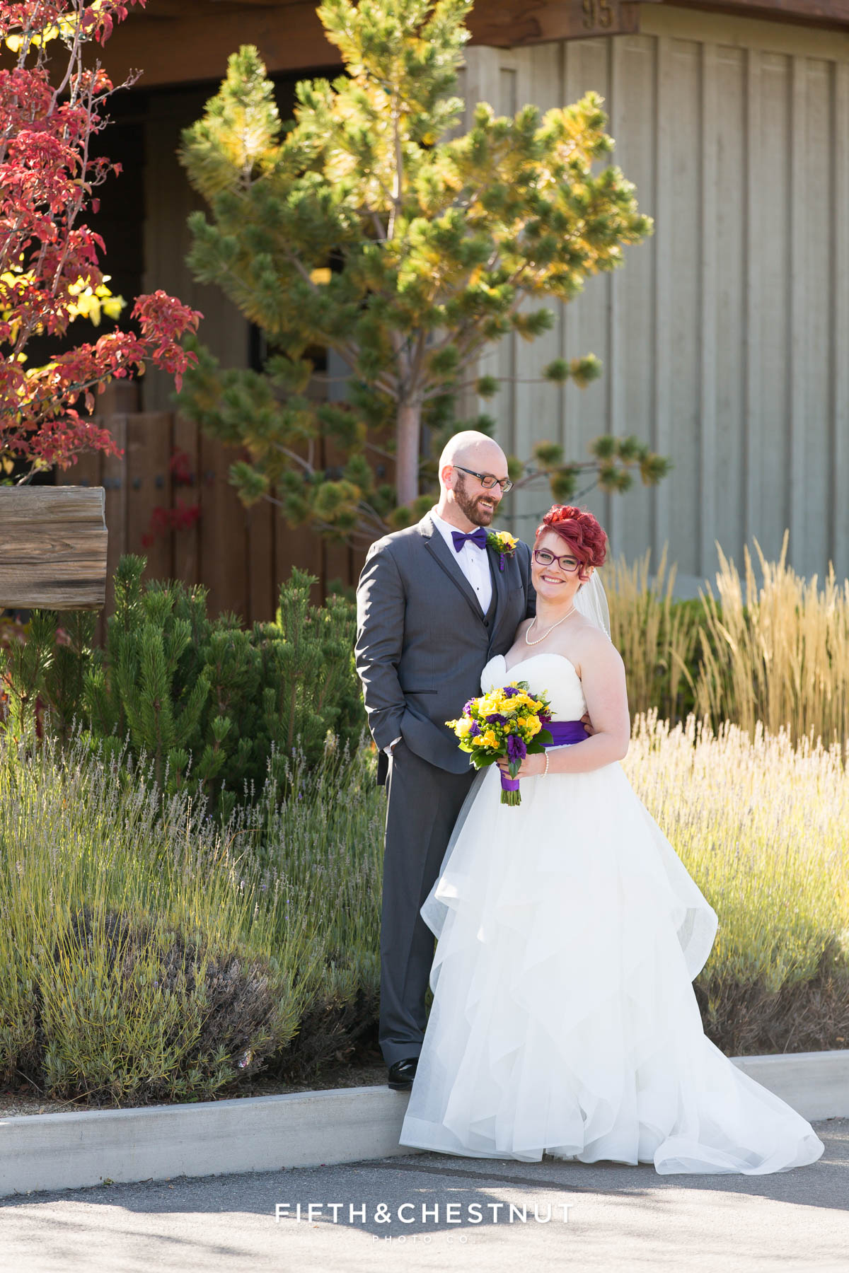 bride and groom portrait in front of their venue for their Bright fall wedding at the Grove by Reno Wedding Photographer