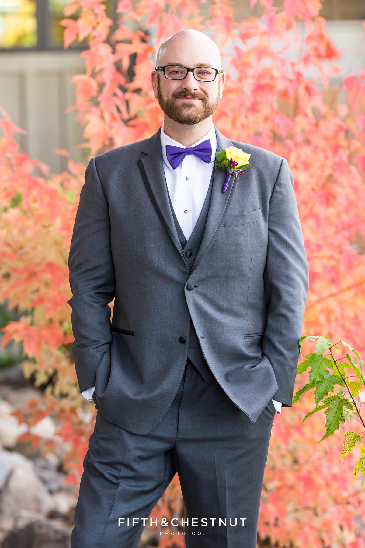 Groom portrait in front of red tree at a Bright fall wedding at the Grove by Reno Wedding Photographer