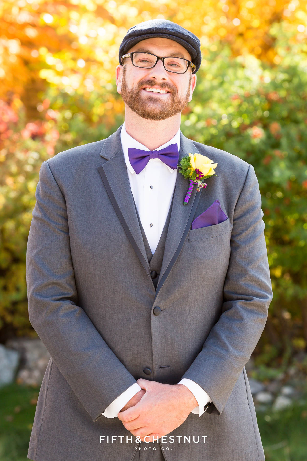 Groom portrait in front of fall foliage for a Bright fall wedding at the Grove by Reno Wedding Photographer