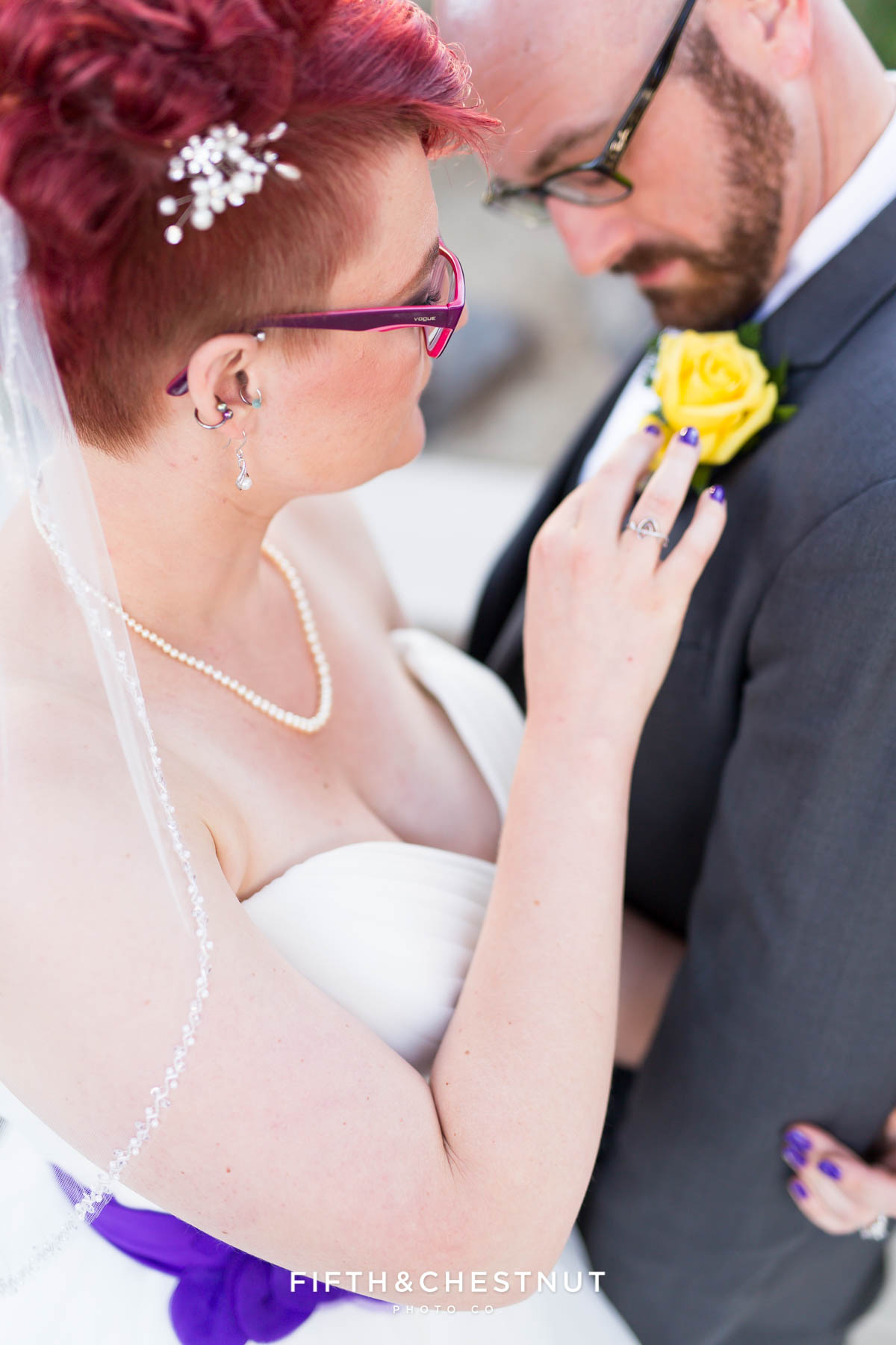 bride inspects groom's boutonniere at a Bright fall wedding at the Grove by Reno Wedding Photographer