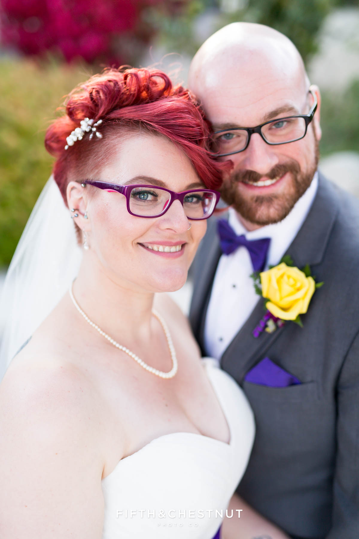 Bride and groom happily smile together at their Bright fall wedding at the Grove by Reno Wedding Photographer