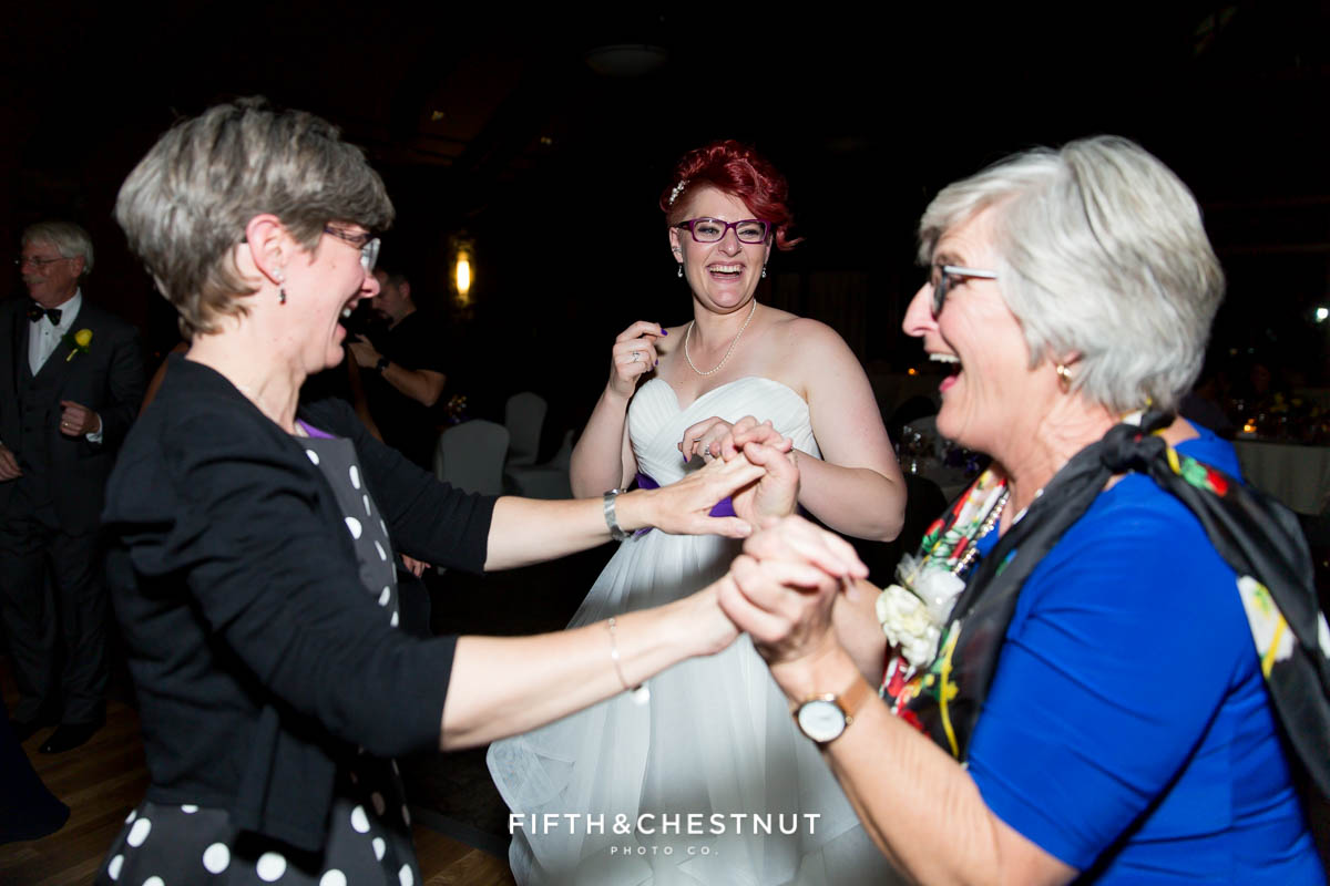 Bride dances with guests at her Bright fall wedding at the Grove by Reno Wedding Photographer