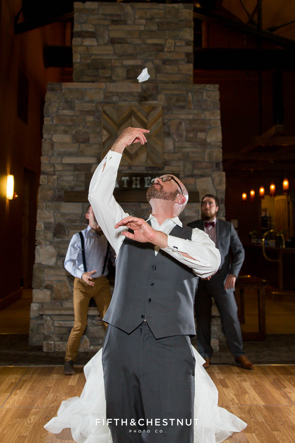 garter toss for a Bright fall wedding at the Grove by Reno Wedding Photographer