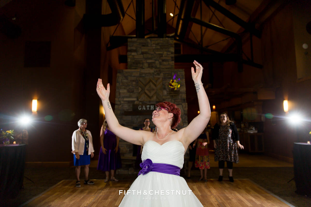 bouquet toss at a Bright fall wedding at the Grove by Reno Wedding Photographer