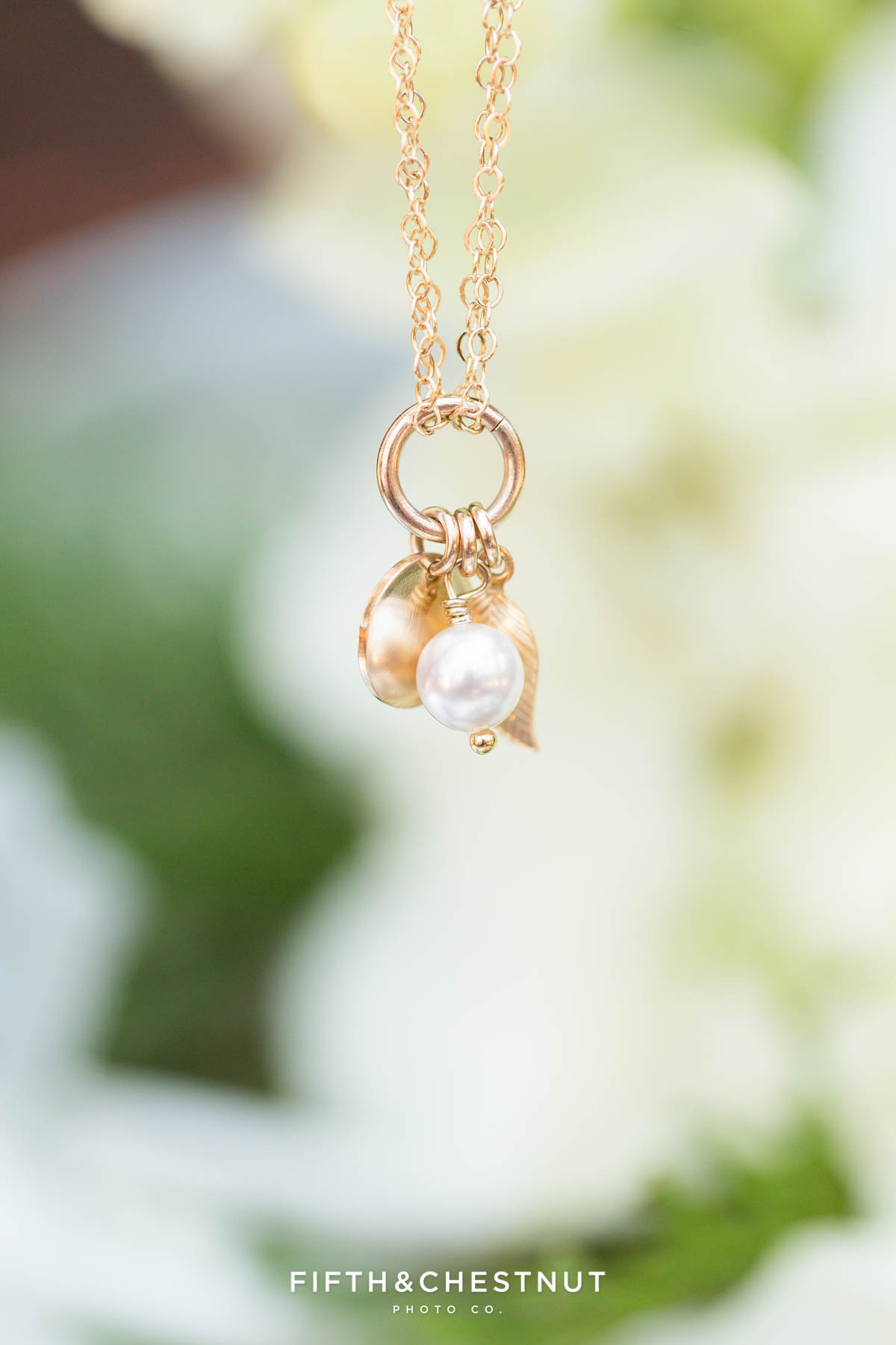 gold and pearl bracelet hanging from a flower for a zephyr cove wedding