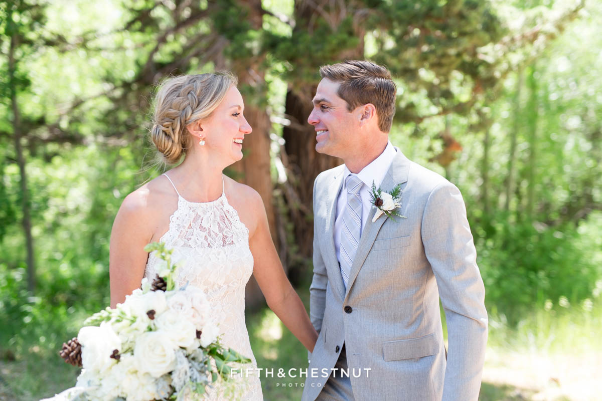 bride and groom laugh after first look for a zephyr cove wedding by lake tahoe wedding photographer