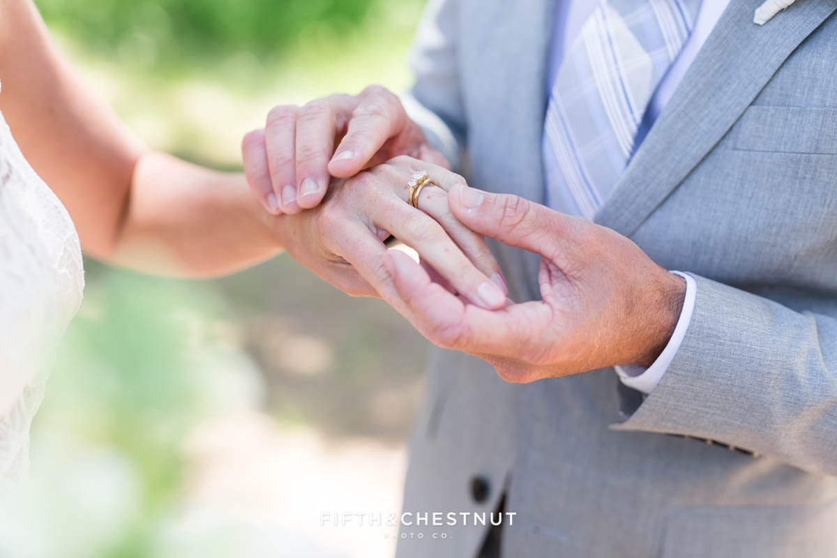 groom looking at the wedding band he bought his bride