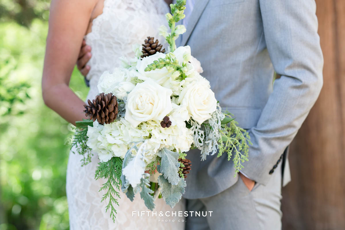 bride and groom with wedding bouquet by twine and dandy