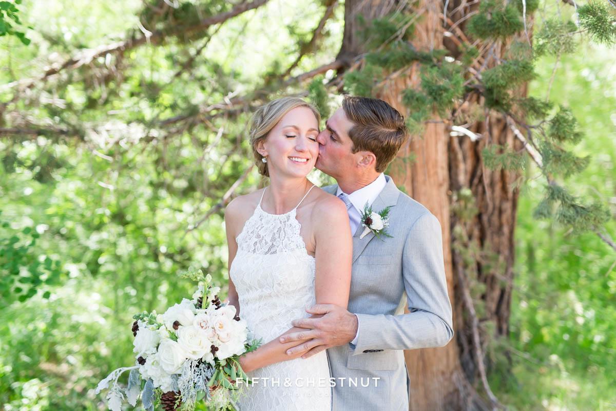 Groom kisses bride on her cheek during their zephyr cove wedding by lake tahoe wedding photographer