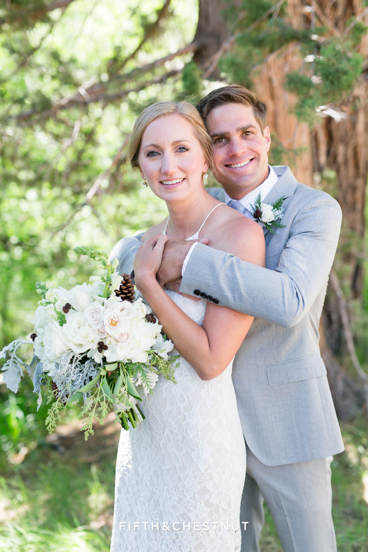 bride and groom snuggling for a portrait for their zephyr cove wedding by lake tahoe wedding photographer