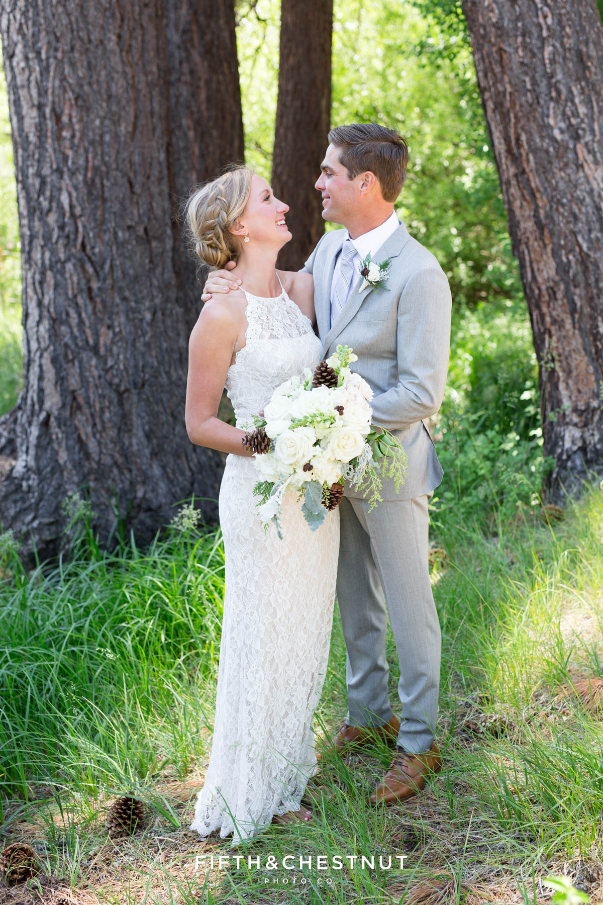 zephyr cove bride and groom look at one another lovingly for portraits by Lake Tahoe wedding photographer