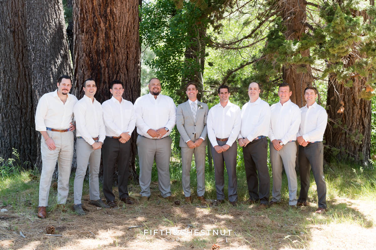 groom and groomsmen pose for a photo for a lake tahoe wedding