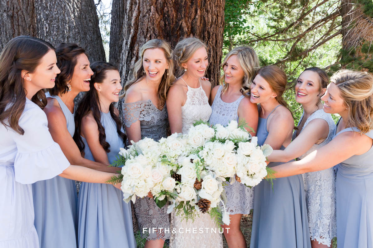 bride and bridesmaids laugh together while showing their bouquets by twine and dandy
