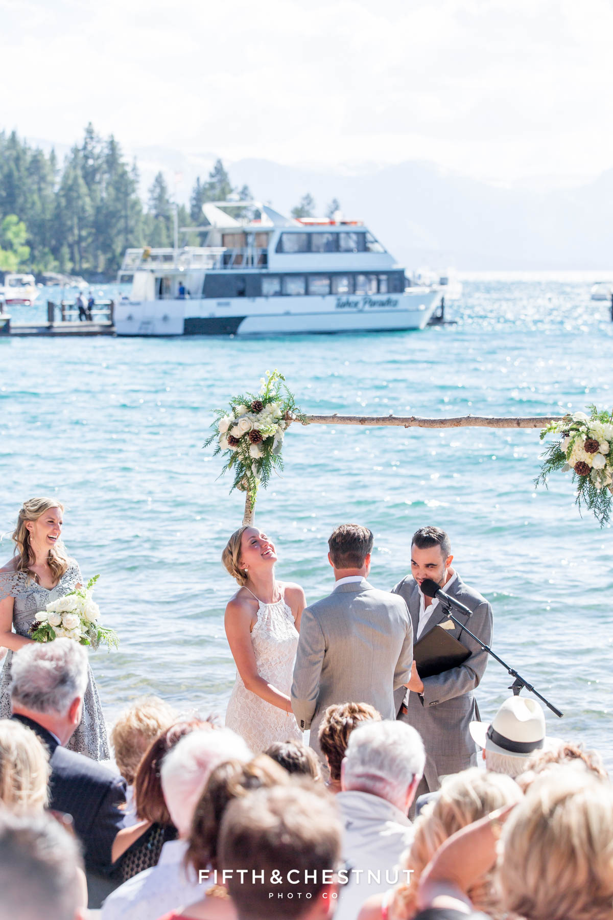 lake tahoe summer wedding ceremony with lake in background by lake tahoe wedding photographer