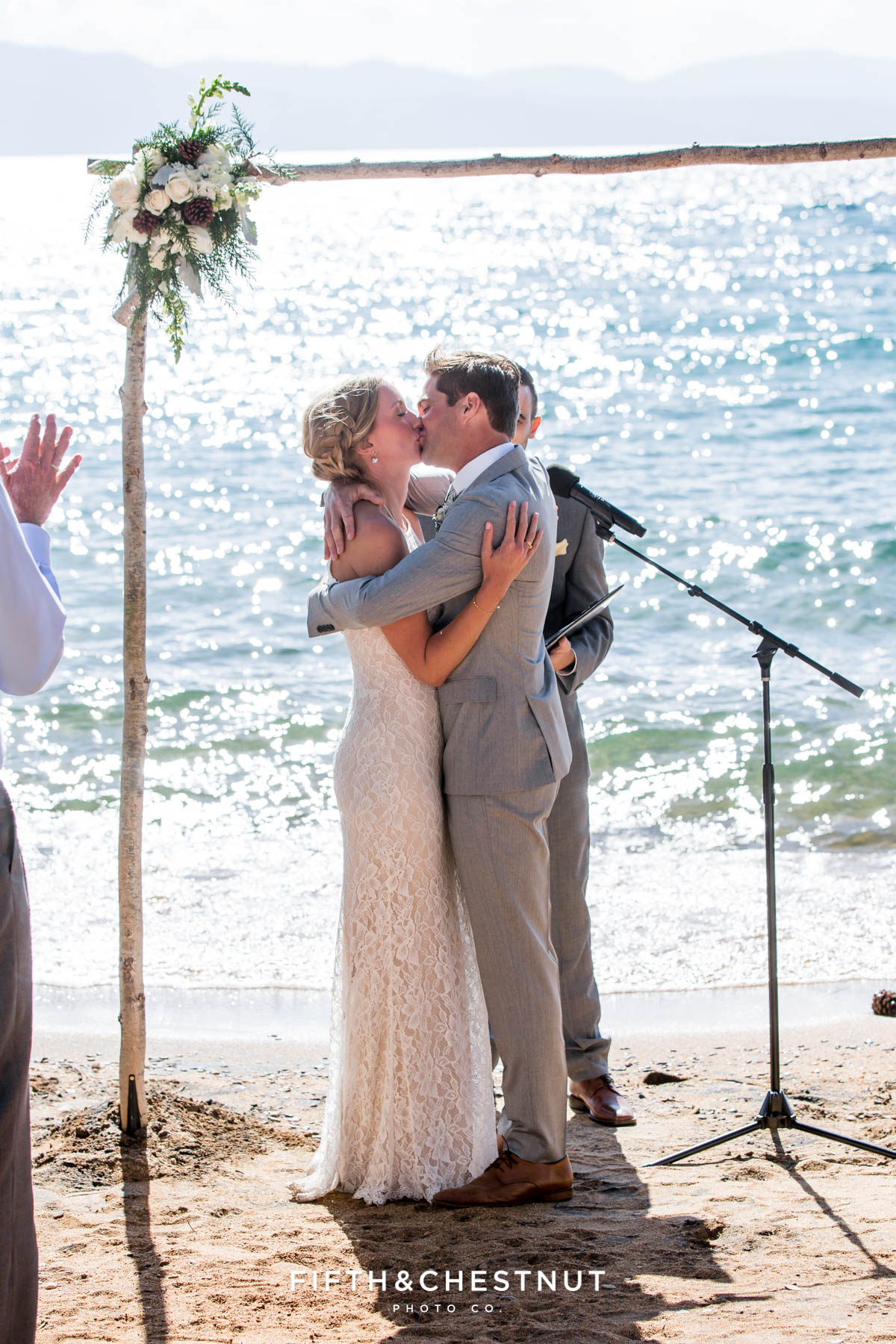 bride and groom become husband and wife and kiss at their lake tahoe wedding