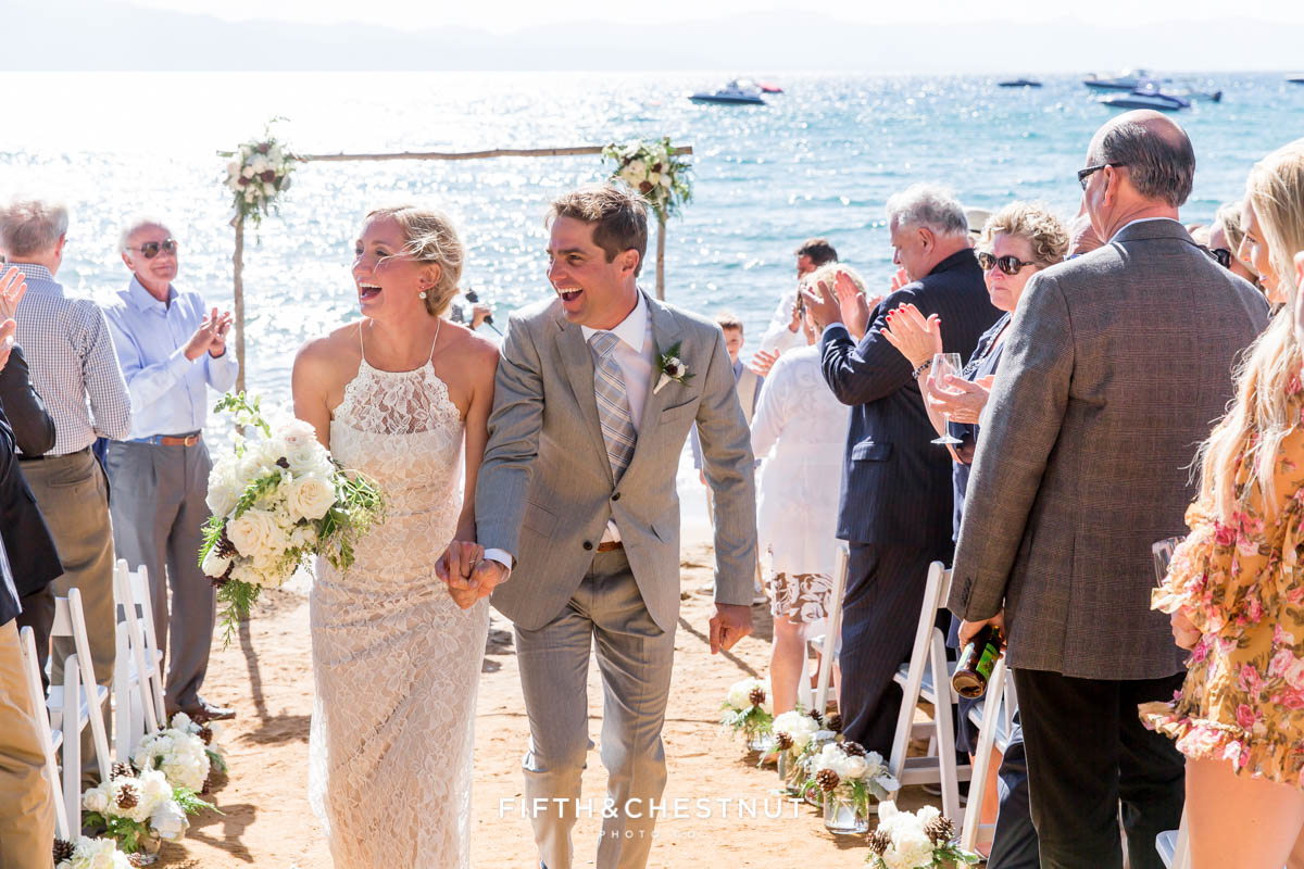 bride and groom walk down the aisle as husband and wife for a lake tahoe wedding