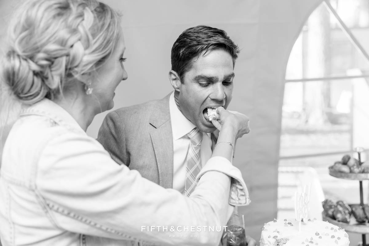 groom eats cake at his lake tahoe wedding
