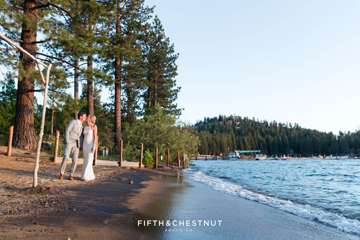 bride and groom kiss on the beach at their lake tahoe wedding